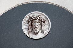 Gravestone with jesus. Gravestone decorated with jesus portrait Royalty Free Stock Image
