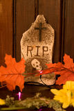 Gravestone with Leaves. Gravestone Halloween decoration with Leaves and Flowers Stock Image