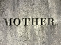 Gravestone: mother. Simple gravestone with engraved mother text Stock Photos