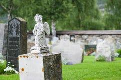Gravestone statue of praying angel Royalty Free Stock Photo
