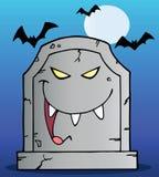 Gravestone under bats on blue Royalty Free Stock Photos