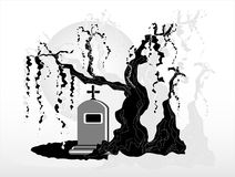 Gravestone under tree. On grey background Stock Photo