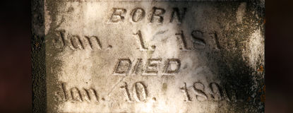Gravestone up close. With birth and death dates Royalty Free Stock Photo