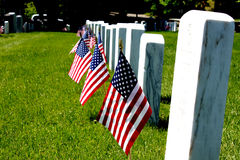Gravestone with US flags. Standing front Royalty Free Stock Image