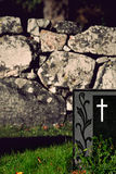 Gravestone with white cross Royalty Free Stock Photos