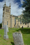 Gravestones and Church Stock Photography