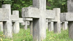 Gravestones cold crosses and fresh green grass in Christian cemetery stock footage