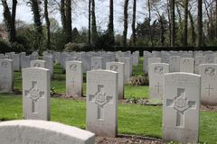 Gravestones of fallen soldiers at the cemetery of Oosterbeek. Gravestones of fallen paratroopers at the cemetery of Oosterbeek after the battle of Arnhem in the Royalty Free Stock Photos