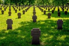 Small cross gravestones in a row stock photos