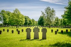 Small cross gravestones in a row stock photography