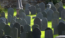 Gravestones. Grey gravestones backlight in graveyard Stock Photo