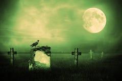 Gravestones i månsken arkivfoto