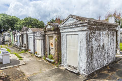 Gravestones at the Lafayette Cemetery No. 1 in New Orleans. NEW ORLEANS, USA - JULY 16, 2013: Historic gravestones at the Lafayette Cemetery No. 1 in New Orleans Royalty Free Stock Photo