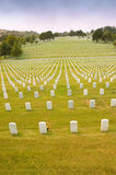 Gravestones in the military cemetary. Manicured lawns among the gravestones in the military cemetary Royalty Free Stock Photo