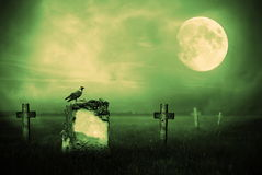 Gravestones in moonlight stock photo