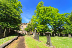 Gravestones at The Parish Church of St Cuthbert. EDINBURGH - MAY 29, 2016: Gravestones at The Parish Church of St Cuthbert on sunny day. This church is one of Stock Photos