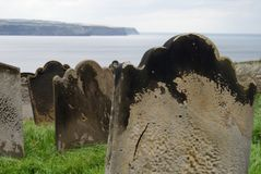 Gravestones by the Sea. A cemetary on the cliffside looking out to sea Stock Image