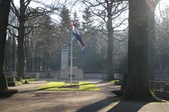 Gravestones and statues on the military field of honour at the Grebberberg in the Netherlands, where lof of solders felt in 5 days. At start of world war II royalty free stock photo