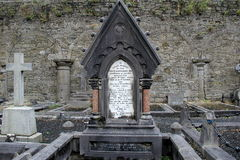 Gravestones and stonewalls,St.Mary's Cathedral, Limerick,Ireland,October,2014 Royalty Free Stock Images