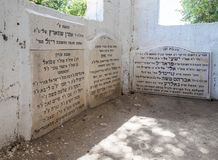 The gravestones with words of gratitude in Hebrew inside the reconstructed tomb Rabbi Nakhman Katufa near the kibbutz Baram in Wes. Bar`am, Israel, June 09, 2018 Stock Photo