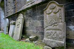 Graveyard. Grave stones in Scotland, read the discription Royalty Free Stock Photo