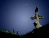 Graveyard. Crows perching on a tombstone in an eerie graveyard in moonlight Royalty Free Stock Photos