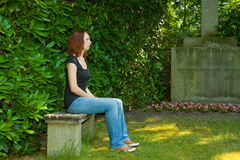 Graveyard. Young woman mourns the death of one belonging royalty free stock images