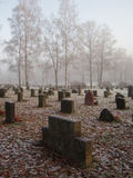 Graveyard. On a misty morning in wintertime stock images