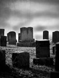 Graveyard. Very old misty and creepy graveyard in black and white Royalty Free Stock Photography