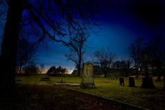 Graveyard. A spooky graveyard at sundown royalty free stock images