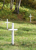Graveyard. Three gravesites Stock Photography