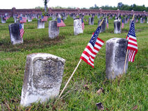 Graveyard with American Flags. National Cemetery in Chalmette, Louisiana Civil War Era Headstones with American Flags Royalty Free Stock Photography