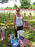 Graveyard with American Flags and Visitors. National Cemetery in Chalmette, Louisiana Civil War Era Headstones with American Flags Stock Photos