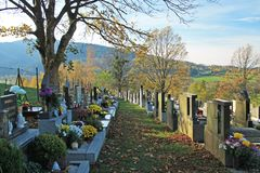 Graveyard in autumn. Decorated graves on the cemetery and some trees in autumn, Prazmo, Czech Republic, November 4, 2017 Royalty Free Stock Image