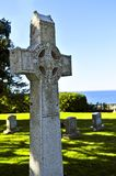 Graveyard with celtic cross. Bright graveyard lawn with ancient celtic crosses Stock Image