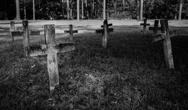 Creepy graveyard with headstone crosses Stock Photos