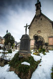 Graveyard at churchyard covered by snow Royalty Free Stock Image