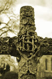 Graveyard Cross. Carved memorial cross, in church grounds Royalty Free Stock Image