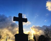 Graveyard cross. Graveyard in Haarlem. Cross with light of sunset. Religion & Christianity Royalty Free Stock Images