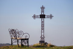 Graveyard cross in silhouette. Against a blue sky Royalty Free Stock Images