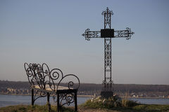 Graveyard cross in silhouette. Against a blue sky Royalty Free Stock Photos