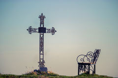Graveyard cross in silhouette. Against a blue sky Royalty Free Stock Photo