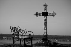 Graveyard cross in silhouette. Against a blue sky Stock Photography