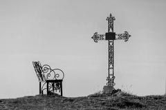Graveyard cross in silhouette. Against a blue sky Stock Photo