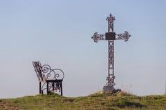 Graveyard cross in silhouette. Against a blue sky Stock Photos
