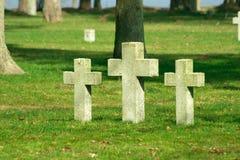 Graveyard crosses on the ground stock photos
