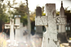 Graveyard crosses. Stone crosses at a cemetery Royalty Free Stock Images