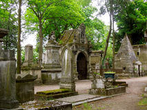 Cemetery Graveyard Pere Lachaise Paris. Ancient crypts and headstones in old cemetery of Paris had restful shade under the trees Royalty Free Stock Photo