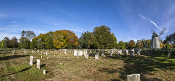 Graveyard in East Hampton with old mill Royalty Free Stock Image