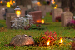 Graveyard at evening. With candles at the headstones, Skogskyrkogarden cemetary in Stockholm, Sweden stock images